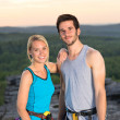 Rock climbing active couple on top sunset — 图库照片