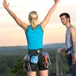 Rock climbing cheerful alpiners on top sunset — Stockfoto