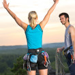 Rock climbing cheerful alpiners on top sunset - Stock Photo