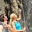 Rock climbing looking pointing up — Stock Photo