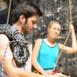 Rock climbing man showing woman rope knot — ストック写真 #6138931