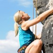 Stock Photo: Rock climbing blond woman on rope sunny