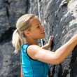 Stock Photo: Rock climbing blond womon rope