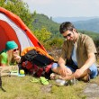 Camping young couple with tent summer countryside - Stock fotografie
