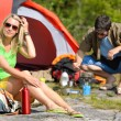 Camping young couple with tent cook countryside — Stock fotografie