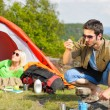 Camping young couple with tent cook countryside — Stock Photo