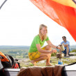 Camping young couple outside tent cook meal — Stock Photo