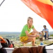 Camping young couple outside tent cook meal — Stock Photo #6139004