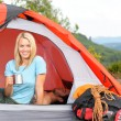 Camping young woman drink mug sunset tent — Stock Photo