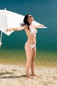Summer beach woman posing in white bikini — Stock Photo