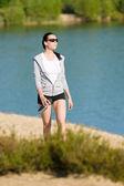 Summer sport fit woman walk on seaside beach — Stock Photo