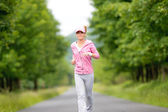 Jogging sportive young woman running park road — Stock Photo