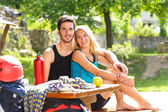 Young couple relax sunny terrace climbing gear — Stock Photo