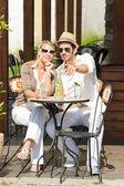 Restaurant terrace elegant couple drink sunny day — Stock Photo