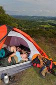 Camping young couple sleeping tent climbing gear — Stock Photo