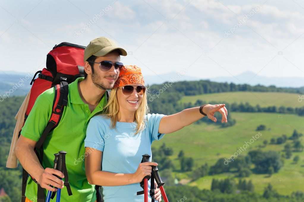 Young backpack couple with hiking poles beautiful panoramic view countryside — Stock Photo #6138989