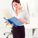 Professional businesswoman attractive look in folder — Stock Photo