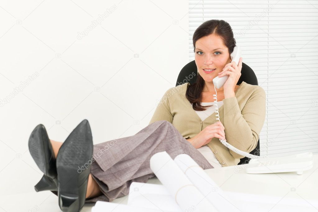 Office relaxation pose professional architect woman sitting behind table — Stock Photo #6212450