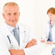 Medical doctor team senior male young woman — Stock Photo