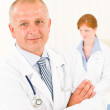 Medical team senior male young woman doctor — Stock Photo