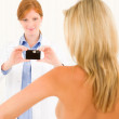Plastic surgery female doctor shoot patient breast — Stock Photo