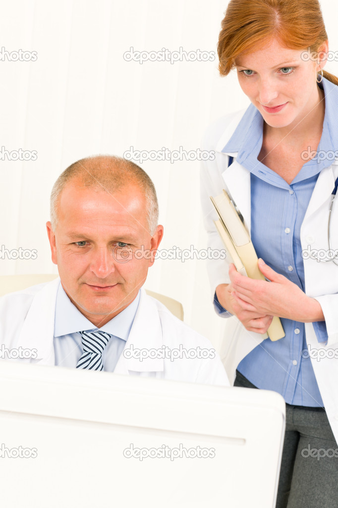 Medical senior doctor male with professional  female colleague look computer — Stock Photo #6287833