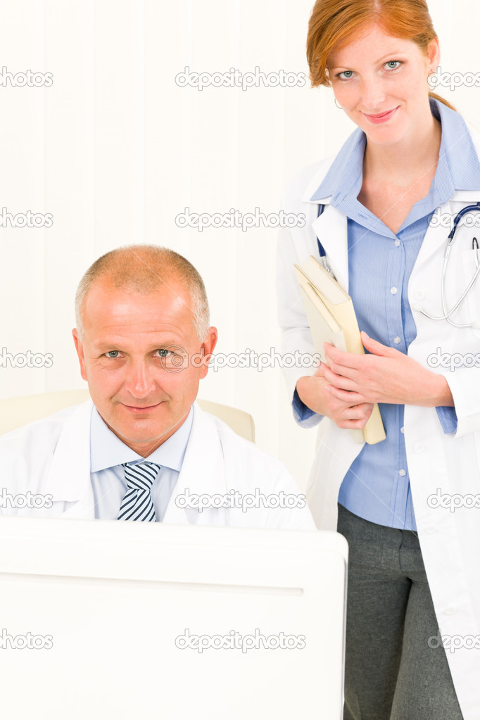 Medical senior doctor male with professional young female colleague office — Stock Photo #6287834