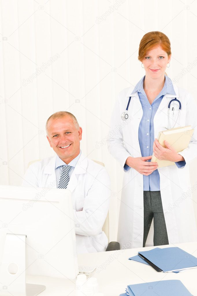 Medical senior doctor male with professional young female colleague office — Stock Photo #6287836