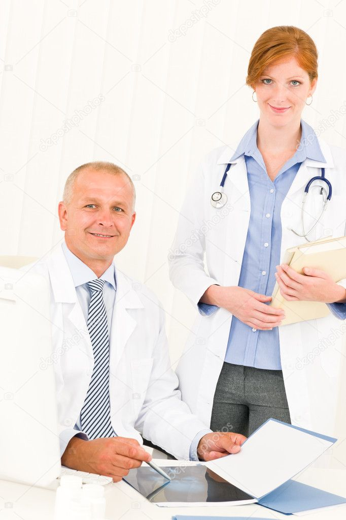 Medical doctor team senior man with female colleague point x-ray — Stock Photo #6287840