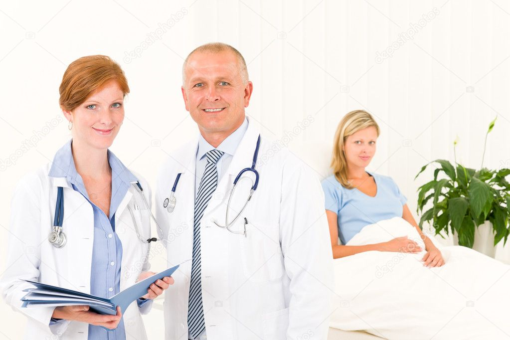 Two medical doctors professional with hospital patient lying in bed — Stockfoto #6287908