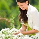 Summer garden beautiful woman care white flowers — Stock Photo