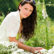 Stock Photo: Summer garden beautiful woman care white flowers