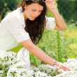 Summer garden beautiful woman white flowers — Stock Photo #6441104
