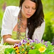 Summer garden beautiful woman care color flowers — Stock Photo #6441110