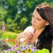 Summer garden flowers beautiful woman dreamy look — Stock Photo