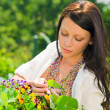 Summer garden beautiful woman care color flowers — Stock Photo #6441130