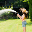 Summer garden woman play with water hose — Stock Photo #6441212