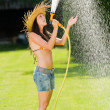 Summer garden woman play with water hose — Stock Photo #6441214
