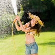 Summer garden woman play with water hose — Stock Photo #6441216