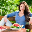 Garden terrace beautiful woman fresh summer fruit — Stock Photo