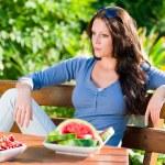 Garden terrace beautiful woman fresh summer fruit — Stock Photo #6441236