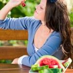 Fresh cherries melon woman garden summer terrace — Stock Photo