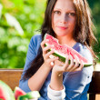 Royalty-Free Stock Photo: Eating fresh melon beautiful young woman bench