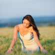 Sunset corn field beautiful brunette woman walk — Stock Photo #6441355
