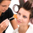 Make-up artist woman fashion model apply powder - Zdjęcie stockowe