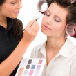 Make-up artist woman fashion model apply eyeshadow — Stock Photo #6441544