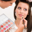 Make-up artist woman fashion model apply lipstick — Stock Photo