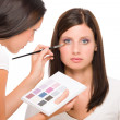 Make-up artist woman fashion model apply eyeshadow - Stock Photo