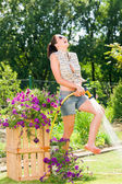 Summer garden smiling woman watering hose flower grass — Stock Photo