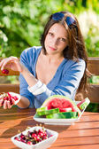 Fresh cherries melon woman garden summer terrace — Stock Photo